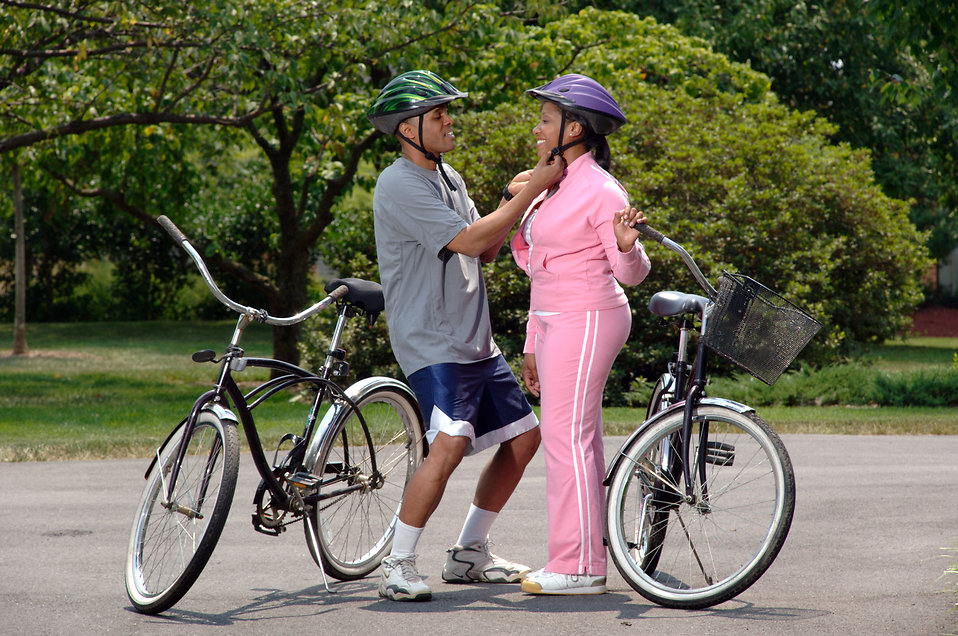 17048-an-african-american-couple-preparing-for-bike-ride-pv